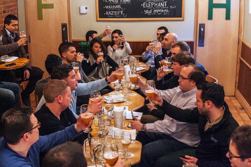 People cheering around craft beer