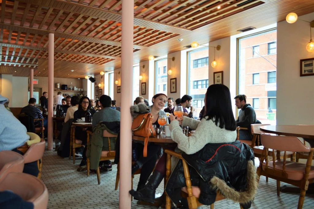 busy interior of breasserie harricana - best brewpubs in montreal